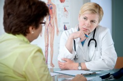 fibromyalgia diagnosis, doctor with patient discussing diagnosis