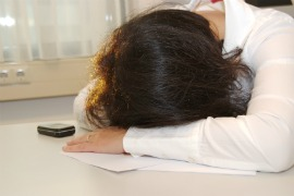fibromyaliga fatigue, tired woman lying down at table