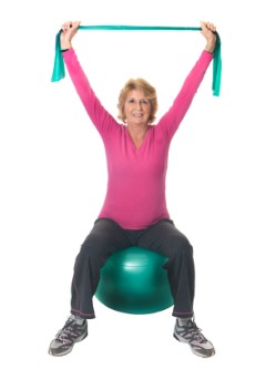 fibromyalgia physical therapy, woman using exercise ball and resistance bands