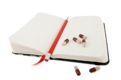 guaifenesin protocol, pills on notepad