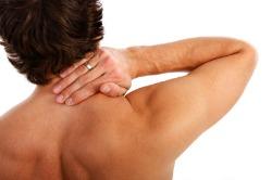 morning stiffness, man holding neck in pain