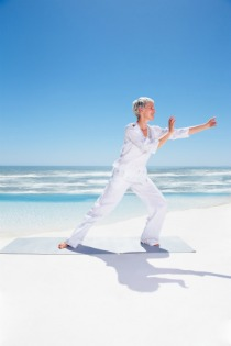 tai chi exercise, woman on beach performing tai chi