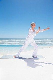 tai chi exercise, woman on beach performing tai chi